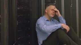 Technician feeling the pressure in server room stock video