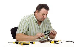 Technician finding damages in the video card Royalty Free Stock Photography
