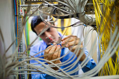 Technician fixing cable Royalty Free Stock Photo
