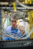 Technician fixing cable Royalty Free Stock Photos