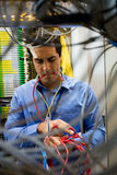 Technician fixing cable Stock Images