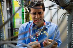 Technician fixing cable stock photography