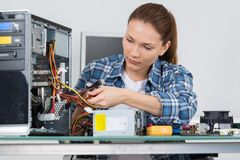 Technician fixing cable in server room stock photos