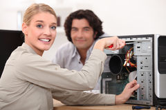 Technician fixing a computer Royalty Free Stock Photo