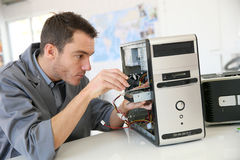 Technician fixing hard drive Stock Photo
