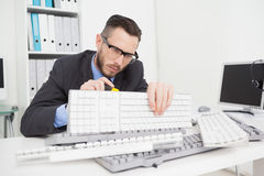 Technician fixing keyboard with screw driver Royalty Free Stock Photos