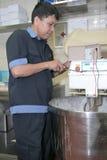 Technician fixing machine Stock Photos