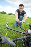 Technician Fixing Propeller Of Surveillance Drone stock photos