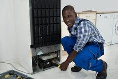 Technician Fixing Refrigerator Stock Photos