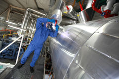Technician fixing technological system stock images