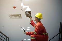 Technician fixing video surveillance CCTV. Technician fixing video surveillance camera or CCTV stock image