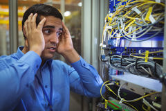 Technician getting stressed over server maintenance Stock Photos