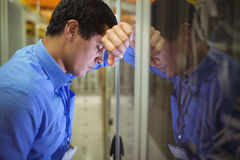 Technician getting stressed over server maintenance Stock Image