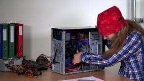 Technician girl upgrading desktop pc ram. stock video