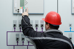 Technician give command in power plant control center. Engineer give command in power plant control center Royalty Free Stock Photos