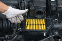 Technician guarantee for changing new air filter for car. Technician guarantee for changing new air filter Royalty Free Stock Image
