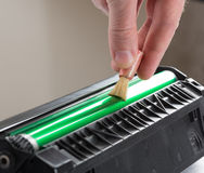 Cleaning printer toner cartridge Stock Photo