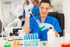 Technician handling liquid Stock Image