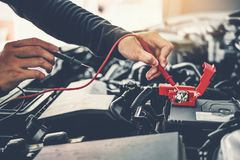 Technician Hands of car mechanic working in auto repair Service and Maintenance car battery.  stock image
