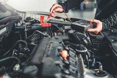 Technician Hands of car mechanic working in auto repair Service and Maintenance car battery.  stock images