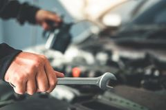 Technician Hands of car mechanic working in auto repair Service and Maintenance car.  royalty free stock image