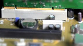 Technician hands with gloves inserting pci card to computer main board stock footage