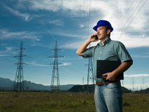 Technician having conversation on phone Royalty Free Stock Image