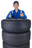 Technician with a heap of tires Stock Photos