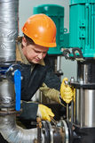Technician of heating system in boiler room. Technician worker of heating system in boiler room Stock Photos