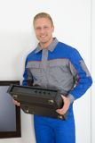 Technician holding amplifier Stock Image