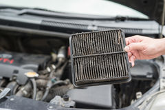 Technician holding dirty air filter Stock Images