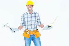 Technician holding hammer and measure tape Royalty Free Stock Photos