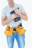 Technician holding handheld drill Stock Photo