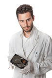 Technician holding hard disk. A technician wearing lab coat holding an hard disk drive Stock Photography