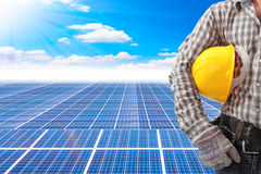 Technician holding helmet working at solar energy power plant ag. Ainst beautiful sky with in concept ecology Royalty Free Stock Photography