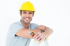 Technician holding pliers while leaning on ladder Royalty Free Stock Images