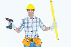 Technician holding portable drill and spirit level Stock Image