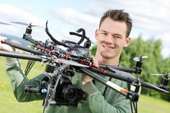 Technician Holding UAV Octocopter Stock Photo