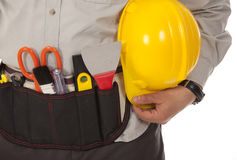 Technician holding yellow helmet Stock Photos