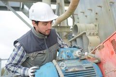 Technician inspecting factory generator Stock Photos