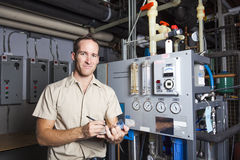Technician inspecting heating system in boiler Royalty Free Stock Images