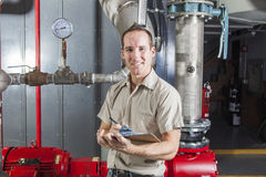 Technician inspecting heating system in boiler Stock Photo