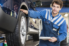 Technician inspection a car Royalty Free Stock Images