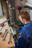 Technician instaling   heating system Stock Photography