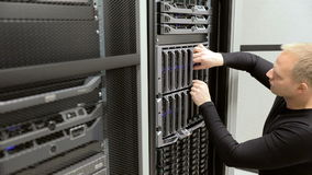 IT technician install harddrive in blade server in datacenter stock footage
