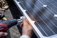 Technician installing solar cell for safe energy stock photo