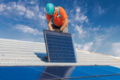 Technician installing solar panel Royalty Free Stock Photo