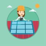 Technician installing solar panel on roof. Royalty Free Stock Photo