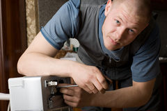 Technician installs a new air conditioner Royalty Free Stock Photos