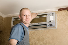 The technician installs a new air conditioner Stock Photography